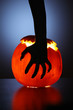 Hand over Halloween pumpkin
