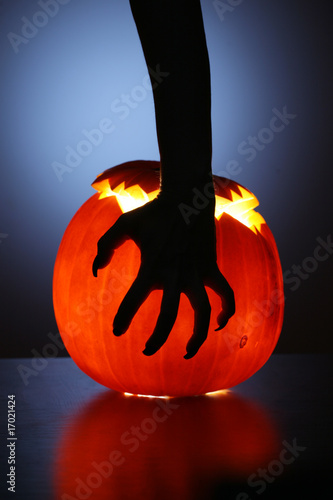 Hand over Halloween pumpkin
