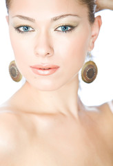 closeup portrait of beautiful young woman with blue eyes