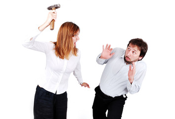 Fighting between male and female isolated, hammer in hand