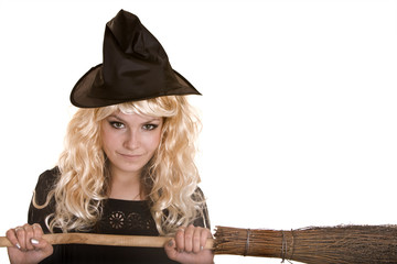 Halloween  witch blond in black dress and hat on broom.
