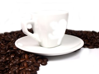 Cup of coffe on coffee beans background