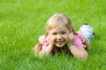 Cute little girl in grass.