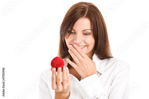 Woman holding box with engagement ring smiling