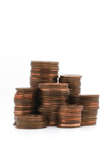 Stacks of copper coins isolated on white