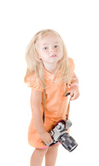 Shot of little girl with camera in studio