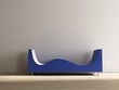 Stylistic blue Couch to face a blank white wall