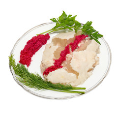 Plate with jellied meat and lettuce isolated on white.