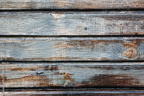 Dark painted weathered wooden fence texture