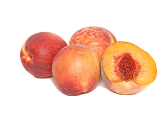 Peaches and section isolated on white background