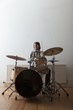 Young man plays drum set
