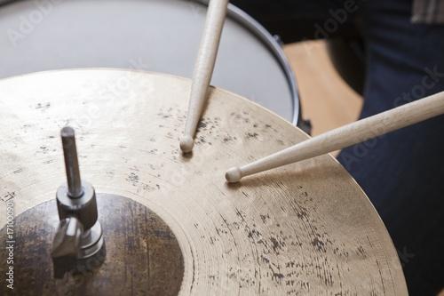 Drumsticks on metal cymbal