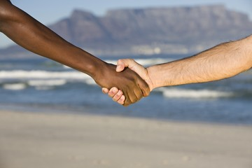 Multi-racial handshake, Table MOuntain beach