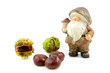 stone autumn doll with chestnuts over white background