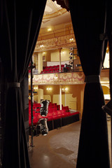 Theatre, view through stage curtain