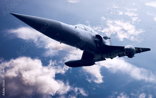 Military airplane on the blue sky