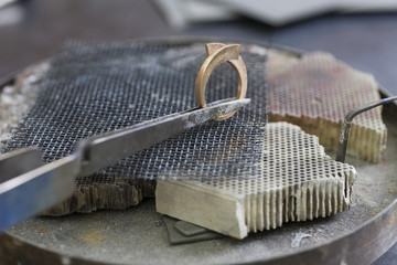 Jewellery making, hand crafting a metal ring