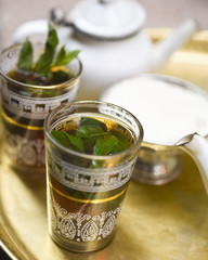 min tea in tea glasses with leaves