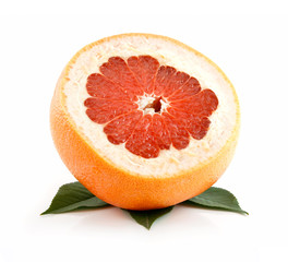 Ripe Sliced Grapefruit with Leaves Isolated on White
