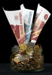 Russian roubles in a glass can