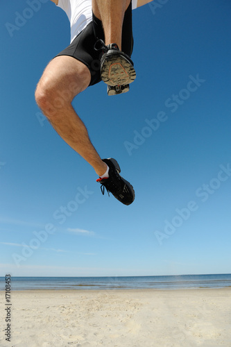 Athlete jumping over camera