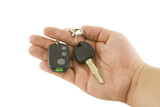 Hand holding key and car alarm system isolated on white backgrou