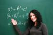 Smiling girl at the blackboard