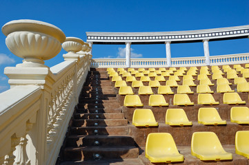 Empty seats in a open-air theatre built in antique Greek style