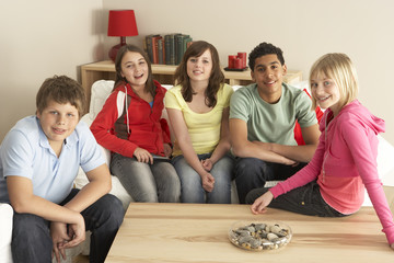 Group Of Children Watching TV At Home