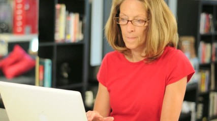 Woman Using a Laptop Computer in a Condo