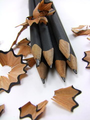 Sharpened pencils with shavings on white background 2