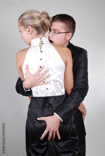 handsome business holding his young secretary in his hands