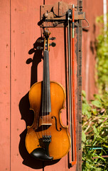Fiddle on a barn door