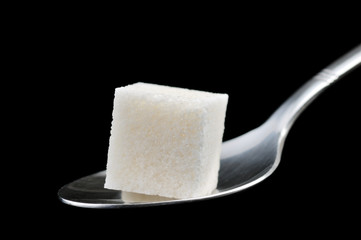Cube of sugar on a spoon