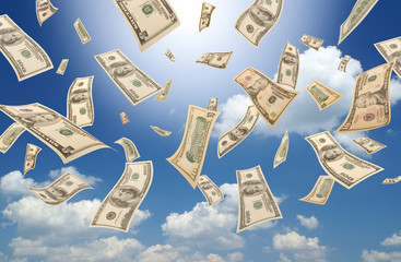 Falling dollars (sunny sky background)