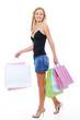 Walking young beautiful woman after shopping