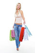 woman with purchases walking after shopping