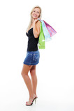 Full-length portrait of  woman with bags of purchases poster
