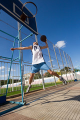 Basketball player is aiming the basket