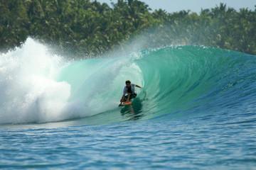 Surfer in barrel on green wave, Mentawai Islands, Indonesia