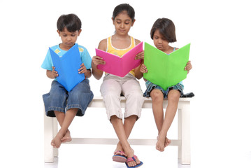 Brother and two sister reading books