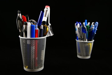 Pencil holder isolated on black.
