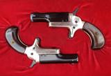 Set of dueling or parlor pistols in original case poster