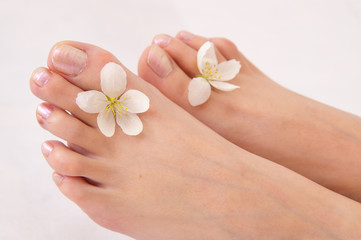 feet with white flowers