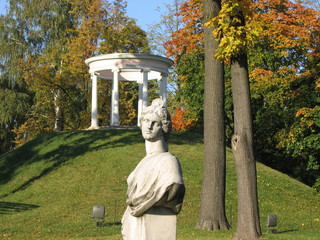 Greek sculpture and architecture in the autumn park