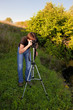 amateur photographer shoots a photo of evening scene