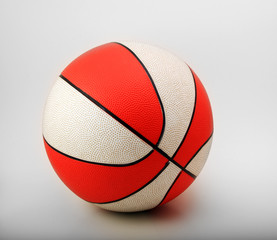 orange and white rubber basketball fully inflated