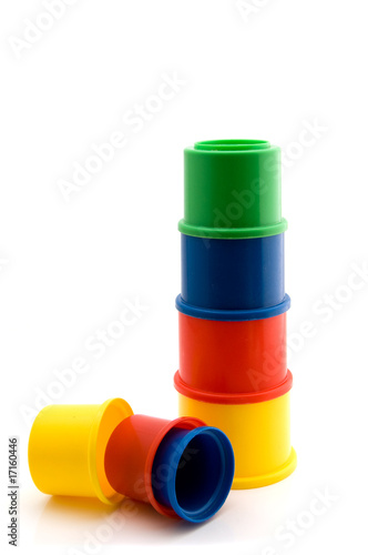 Tower of colorful cups as a toy for little children on white