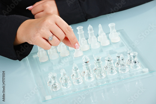Humand hands playing chess