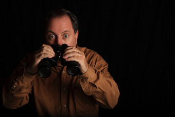 Man Shocked With a Large Pair of Binoculars